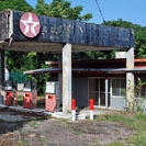 The old Texaco station at Bailey. Today there is just one petrol station on the island. There is also a landing strip, a diesel-powered electricity generating plant, two cash points, several hotels and patchy internet access.